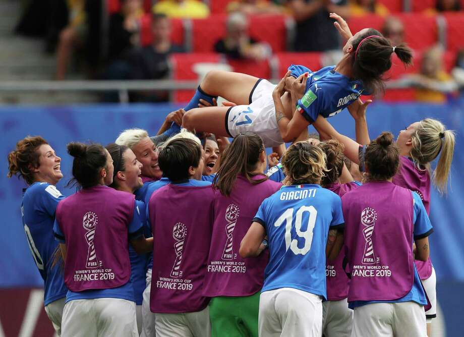 Italy's Barbara Bonansea is tossed in the air by teammates after their victory in the Women's World Cup Group C soccer match between Australia and Italy at the Stade du Hainaut in Valenciennes, Sunday, June 9, 2019. (AP Photo/Francisco Seco) Photo: Francisco Seco / Copyright 2019 The Associated Press. All rights reserved