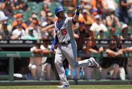 SAN FRANCISCO, CA - JUNE 09:  Max Muncy #13 of the Los Angeles Dodgers celebrates as he trots around the bases after hitting a solo home run against the San Francisco Giants in the top of the first inning of a Major League Baseball game at Oracle Park on June 9, 2019 in San Francisco, California.  (Photo by Thearon W. Henderson/Getty Images)