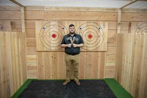 Blake Cryer is co-owner of Axeaholics Hatchet House, which opened Saturday at 2730 Grandview Ave. in Odessa.
