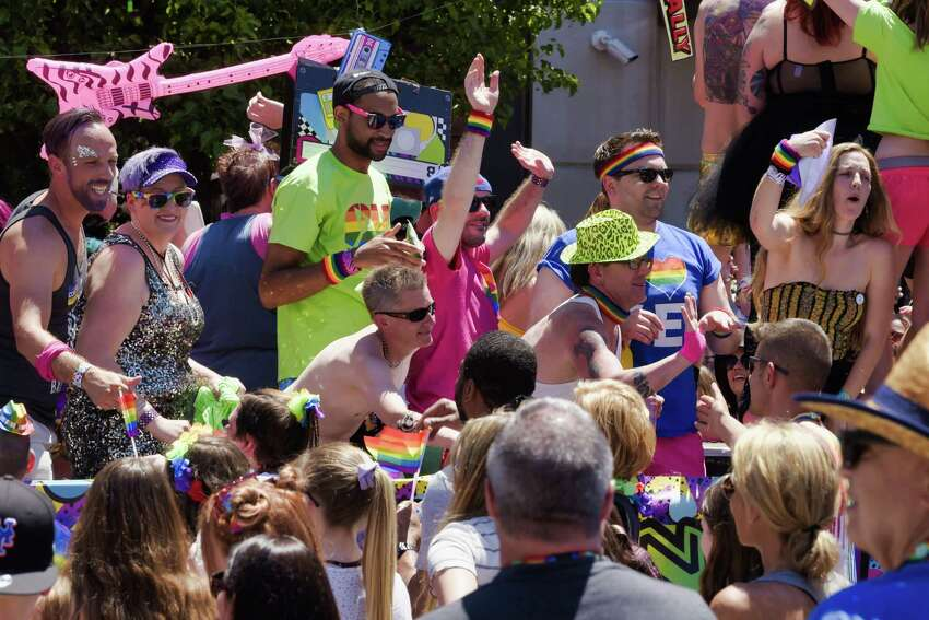 People riding on the Oh Bar float celebrate with spectators along Lark Street during the Capital Pride Parade on Sunday, June 9, 2019, in Albany, N.Y. (Paul Buckowski/Times Union)