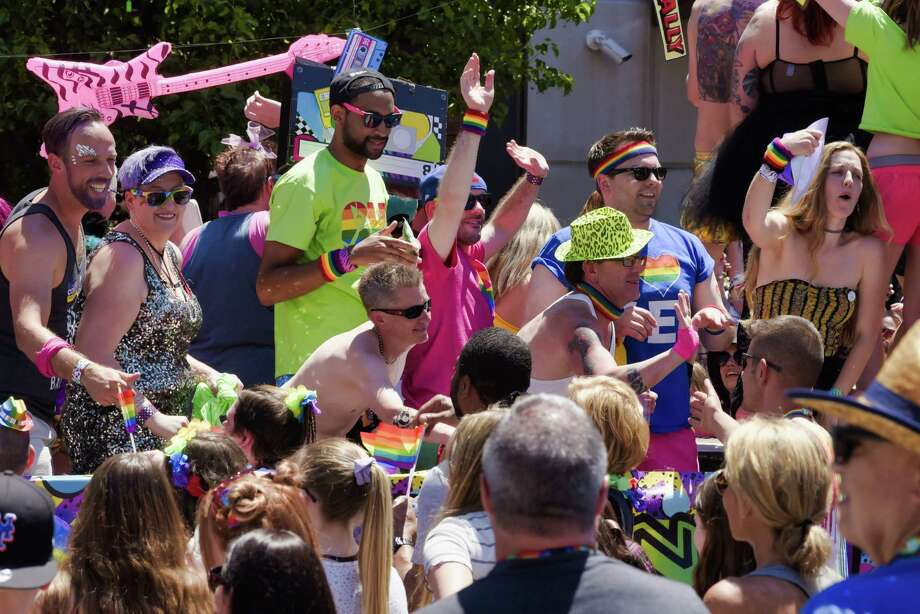 People riding on the Oh Bar float celebrate with spectators along Lark Street during the Capital Pride Parade on Sunday, June 9, 2019, in Albany, N.Y.  (Paul Buckowski/Times Union) Photo: Paul Buckowski / (Paul Buckowski/Times Union)