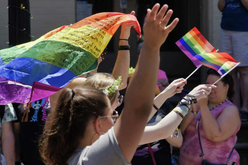 Participants in the Capital Pride Parade make their way along Lark Street as spectators cheer from the sides on Sunday, June 9, 2019, in Albany, N.Y. (Paul Buckowski/Times Union)