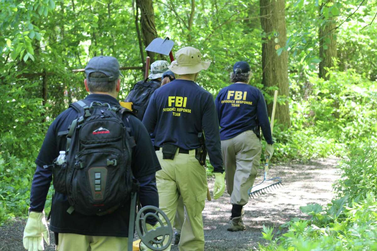 Members of an FBI Evidence Response Team searched Waveny Park near the bridge that carries Lapham Road over the Merritt Parkway Monday, June 3, as part of the Jennifer Dulos case.