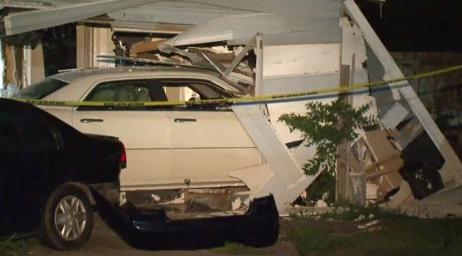 Two people were arrested Sunday night after driving through a southeast Houston home with a family inside, according to Metro Video. Photo: Metro Video