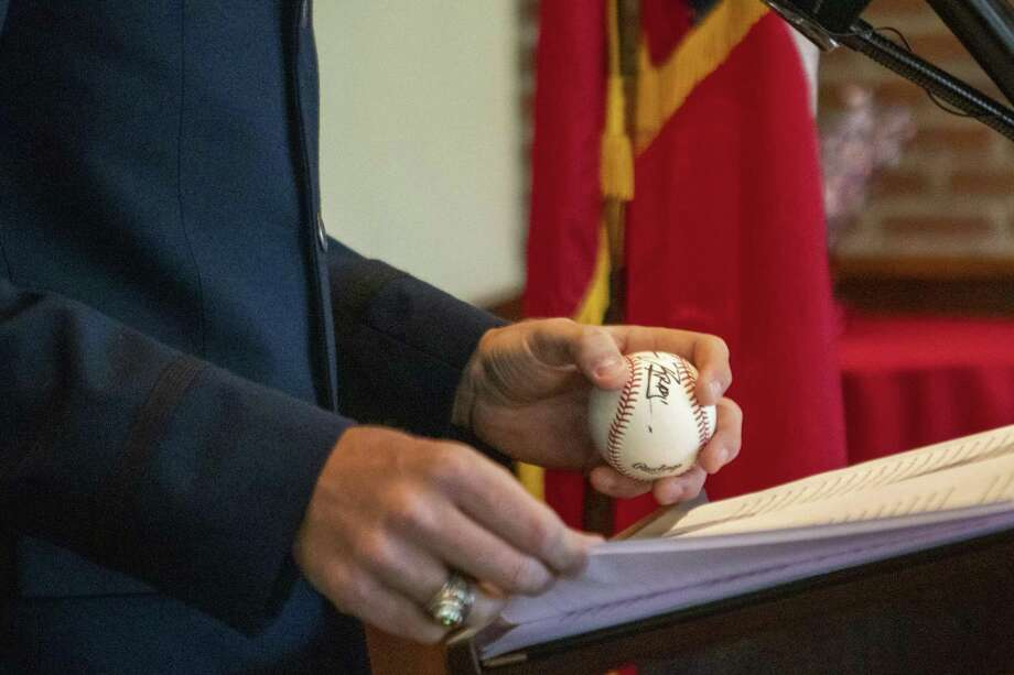 Tyler Mortenson, Air Force lieutenant and College Park graduate, grips a baseball signed by U.S. Rep Kevin Brady he received in junior high school during the 2019 Academy Send Off Breakfast on Saturday, June 8, 2019 at Black Walnut Cafe in The Woodlands. Photo: Cody Bahn, Houston Chronicle / Staff Photographer / © 2018 Houston Chronicle