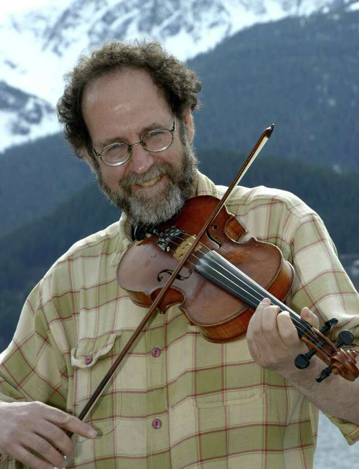 PAIR OF CONCERTS: Alaska's fiddling poet Ken Waldman returns with his show to The Buttonwood Tree, 605 Main St. in Middletown, for the first time in over a decade Sunday, June 9, at 6:30 p.m. Tickets are $15; www.buttonwood.org or 860-347-4957. Then, on Tuesday, June 11, Waldman brings Binghamton musicians, Brian Vollmer and Claire Byrne to join him for two shows in New Haven at The International Festival of Arts & Ideas at 1:15 p.m. on the Green. Photo: Ken Waldman / Contributed Photo
