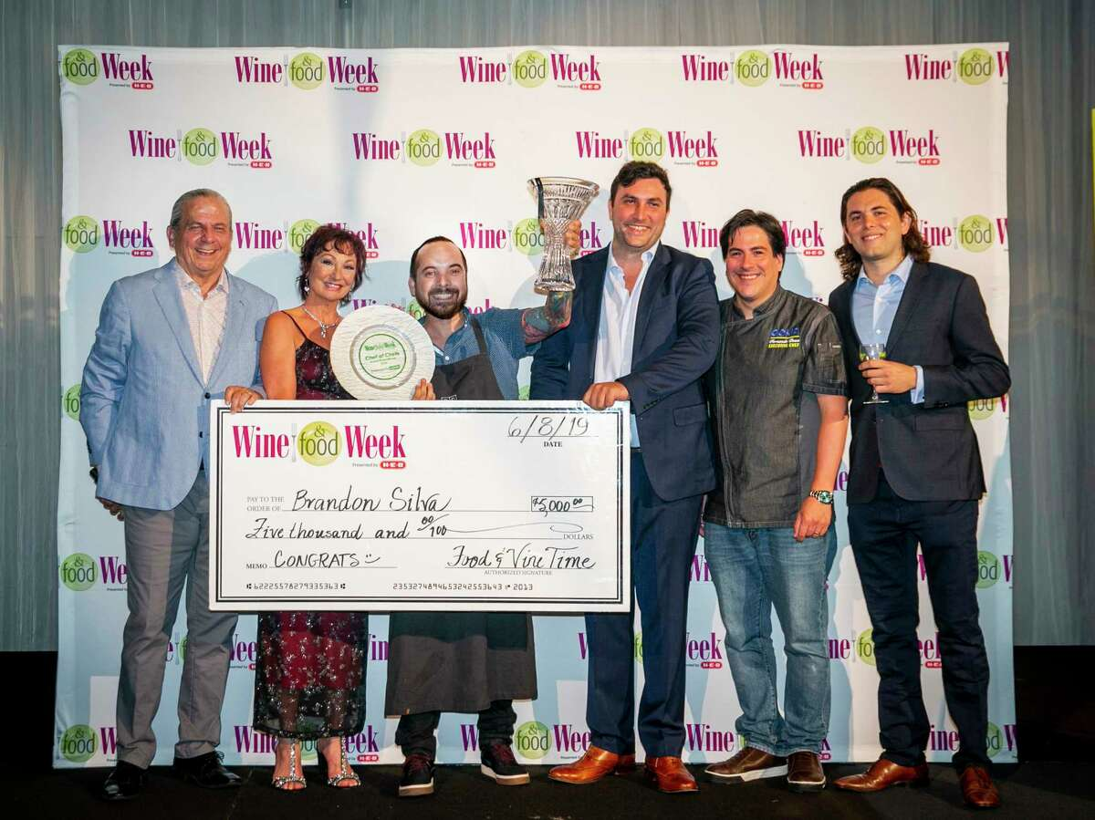chef Brandon Silva of Wooster's Garden, center, took first place in the chef competition at the 15th annual Wine & Food Week in the Woodlands Saturday. He is shown with event founders Clifton and Constance McDerby, and Tony Unanue, chef Fernando Desa and Tommy Unanue of Goya Foods. Goya, an event sponsor, donated the Waterford crystal trophy.