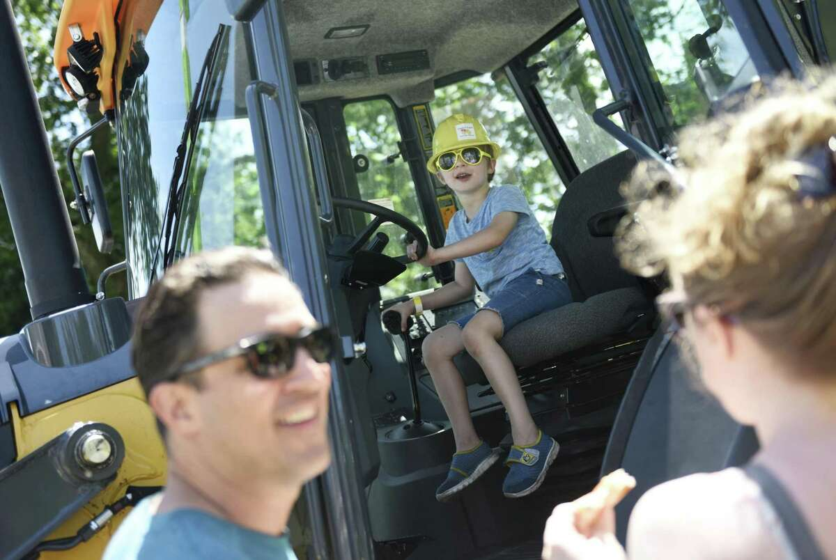 Old Greenwich's Henry Stuller Zessman, 5, sits in a loader at the 17th annual Touch a Truck event at Town Hall in Greenwich, Conn. Sunday, June 9, 2019. The kids event benefits the Junior League of Greenwich and features powerful trucks from Greenwich's Department of Public Works as well as firetrucks, police cars and motorcycles, ambulances, and heavy duty construction vehicles. Additionally, there were a wide variety of kids activities, musical performances, and food trucks.