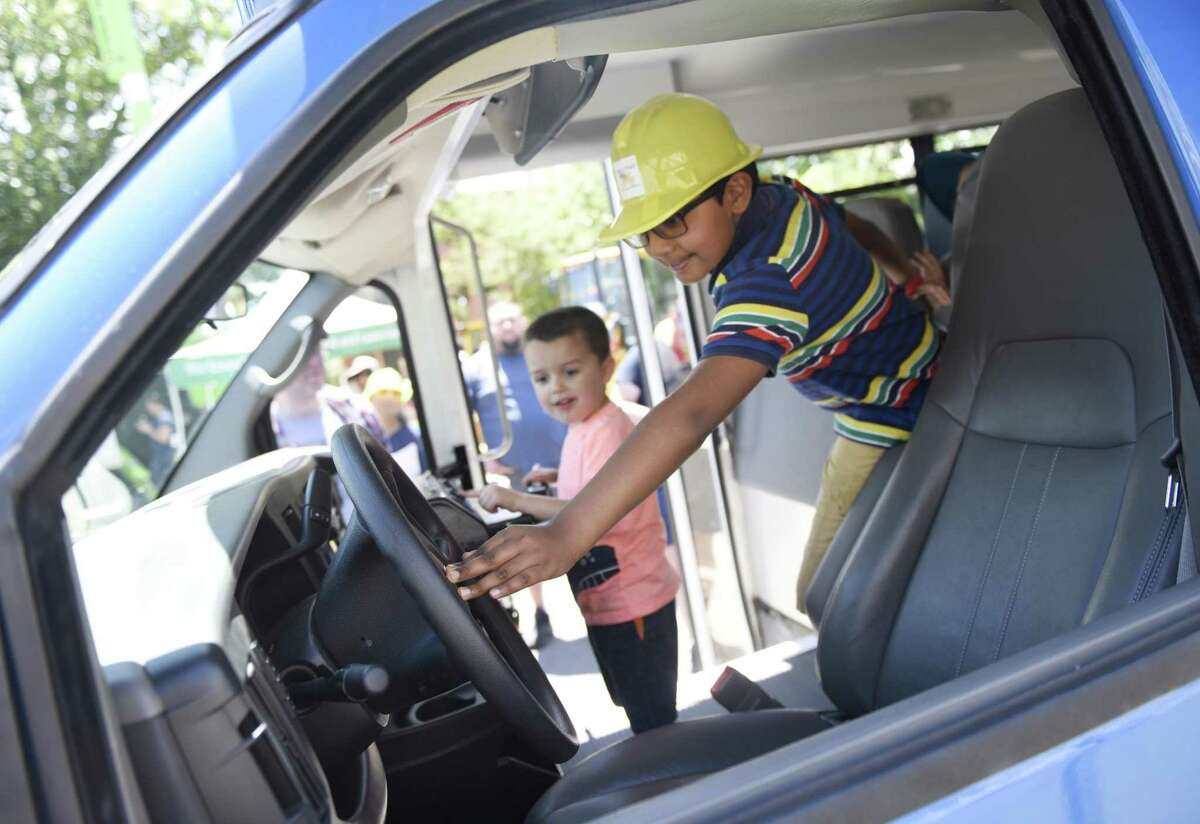 Greenwich's Satyea Mohan, 9, honks the horn in a Whitby School bus at the 17th annual Touch a Truck event at Town Hall in Greenwich, Conn. Sunday, June 9, 2019. The kids event benefits the Junior League of Greenwich and features powerful trucks from Greenwich's Department of Public Works as well as firetrucks, police cars and motorcycles, ambulances, and heavy duty construction vehicles. Additionally, there were a wide variety of kids activities, musical performances, and food trucks.