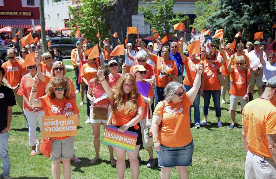 A moment of flag waving for solidarity at the Wear Orange rally at Sherman Green on Sunday, June 9, 2019, in Fairfield, Conn. Photo: Jarret Liotta / For Hearst Connecticut Media / Fairfield Citizen News Freelance