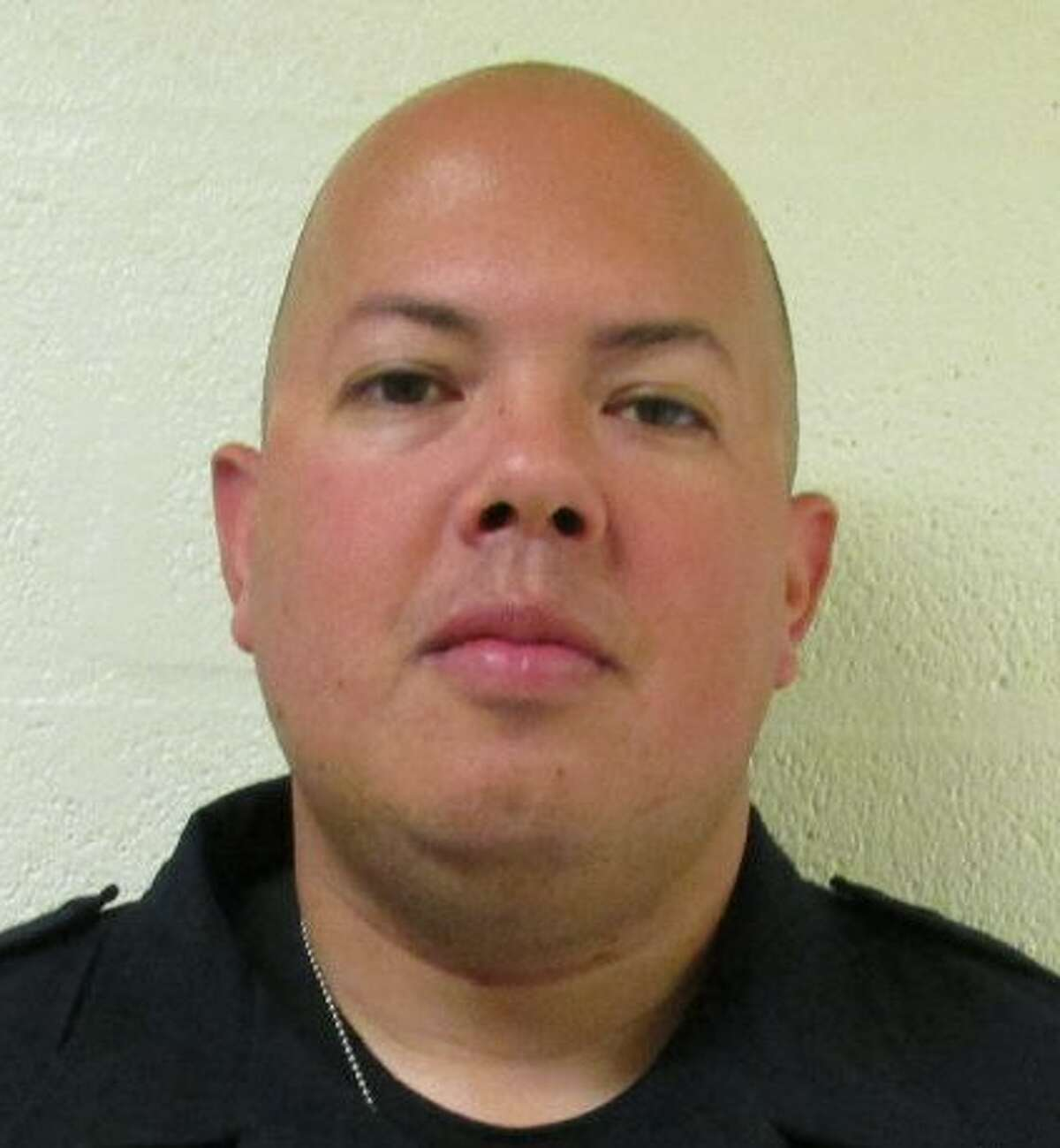 Corporal Justin Storlie, 35, was arrested Monday on a domestic violence charge.