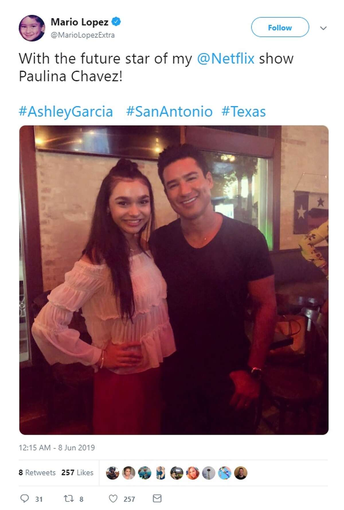 Mario Lopez takes a picture with actress Paulina Chavez while in San Antonio on Saturday.