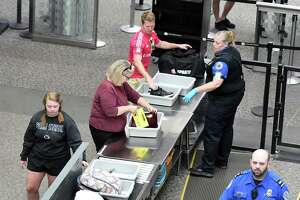 Transportation Security Administration personnel inspect travelers on Monday, June 10, 2019, at Albany International Airport, in Colonie, N.Y.  (Catherine Rafferty/Times Union)