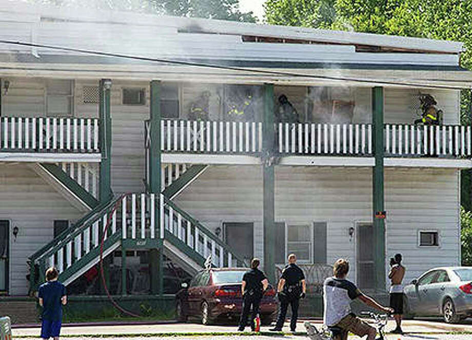 Firefighters were called about 3:41 p.m. Sunday and found fire in the exterior second-floor walkway and roof of 740 E. Douglas Ave. Photo: Richard Blough | Contributor