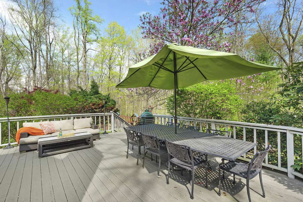Another wide deck offers a sitting area and an al fresco dining space.