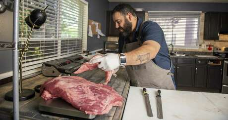 Andy Lugo, who has started up his own Meat Hussler business, caters to competition barbecue enthusiasts. He hand-selects the perfect meats, then trims up briskets and ribs so they are ready for seasoning and the pits.