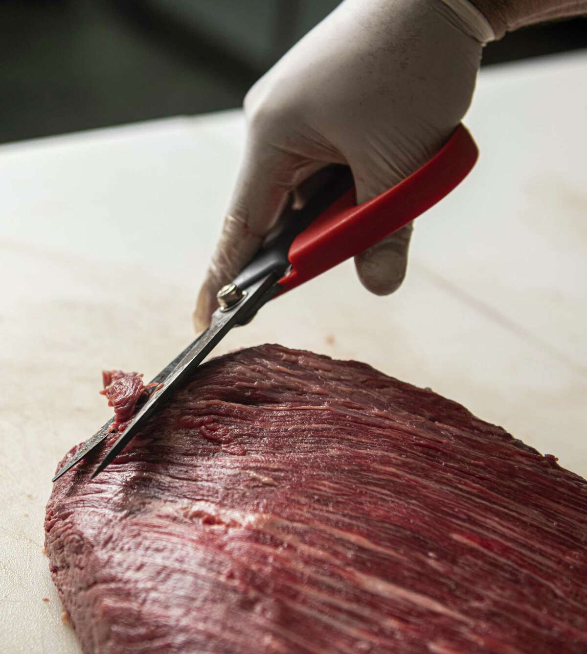 Andy Lugo trims up a Wagyu brisket that he can finish in about seven minutes.