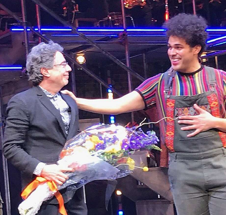 "Tony Taccone receives a bouquet from Joel Perez onstage after the opening of ""Kiss My Aztec"" at Berkeley Rep. Photo: Leah Garchik / The Chronicle"