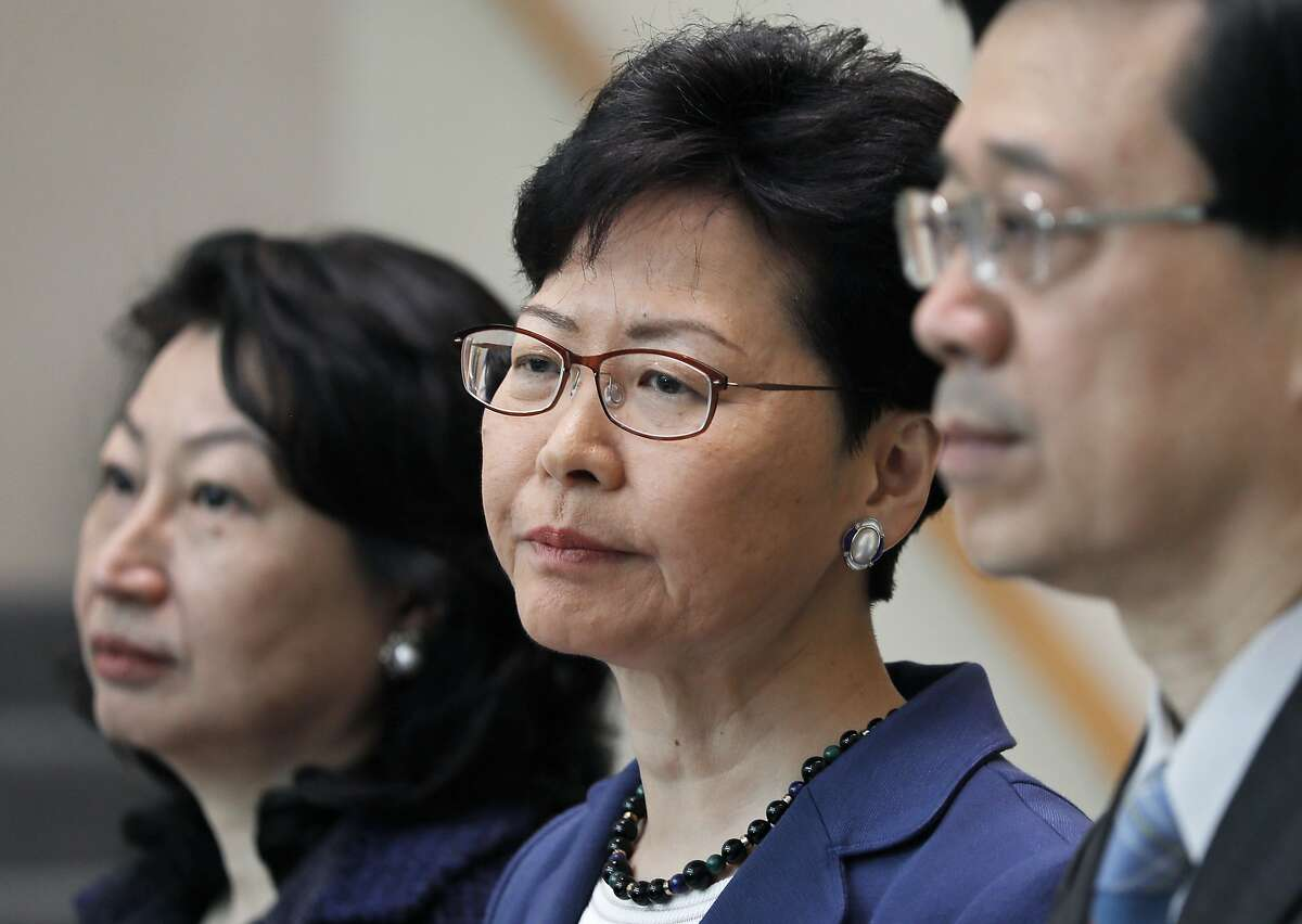 Hong Kong Chief Executive Carrie Lam (center) says she will not back down from pursuing contentious legislation that would allow extraditions of suspects to mainland China.