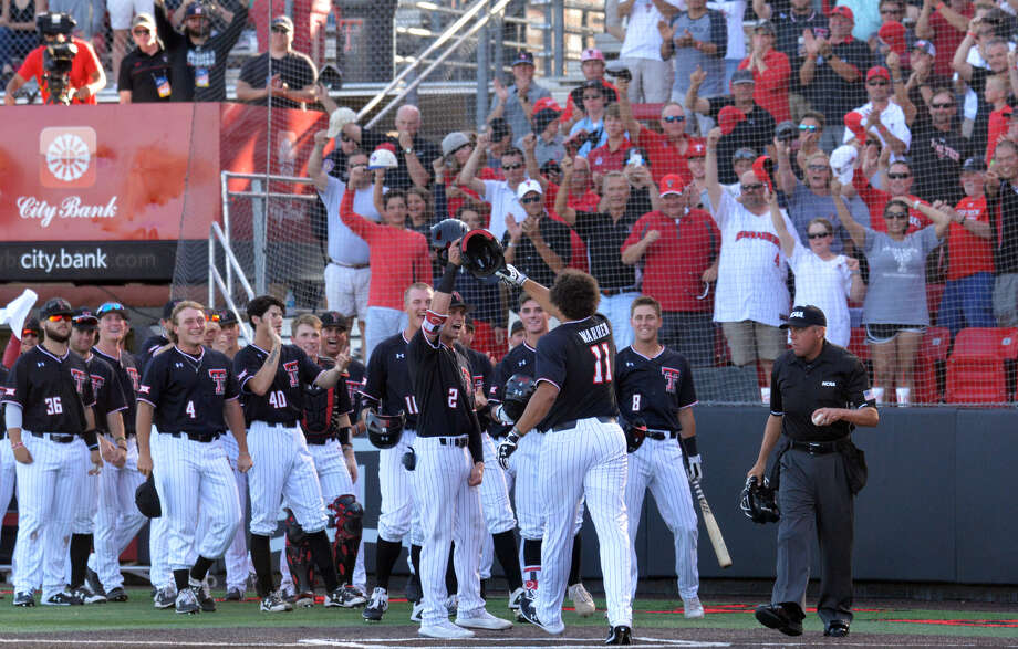 The Texas Tech Red Raiders are headed back to the College World Series after taking the Super Regional series against Oklahoma State 2-1, coming away with an 8-6 win in the finale on Sunday night on Dan Law Field at Rip Griffin Park. Photo: Nathan Giese/Planview Herald