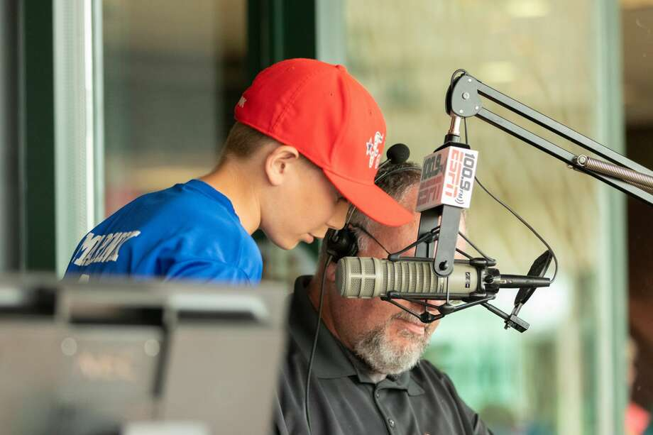 A member of the Kids Club takes a turn at announcing during Sunday's win over South Bend at Dow Diamond. Photo: Alex Seder/Great Lakes Loons