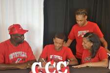 Beaumont United triple jumper Drezden Brannon (middle) signs his national letter of intent to compete at Coffeyville Community College next season. Photo provided by Drezden Brannon.