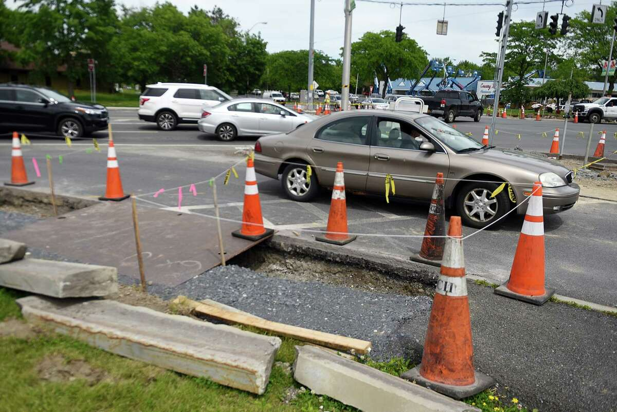 Construction workers repair an existing sidewalk on Columbia Turnpike at Route 4 on Monday, June 10, 2019, in East Greenbush, N.Y. The town of East Greenbush is looking to build a sidewalk on Columbia Turnpike between Hannaford Plaza, at Route 4, heading east to Hays Road. (Catherine Rafferty/Times Union)