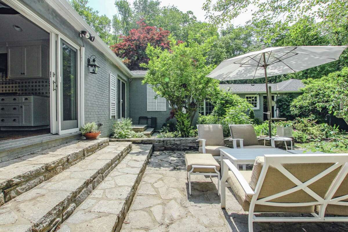 Off the kitchen there is a stone patio.