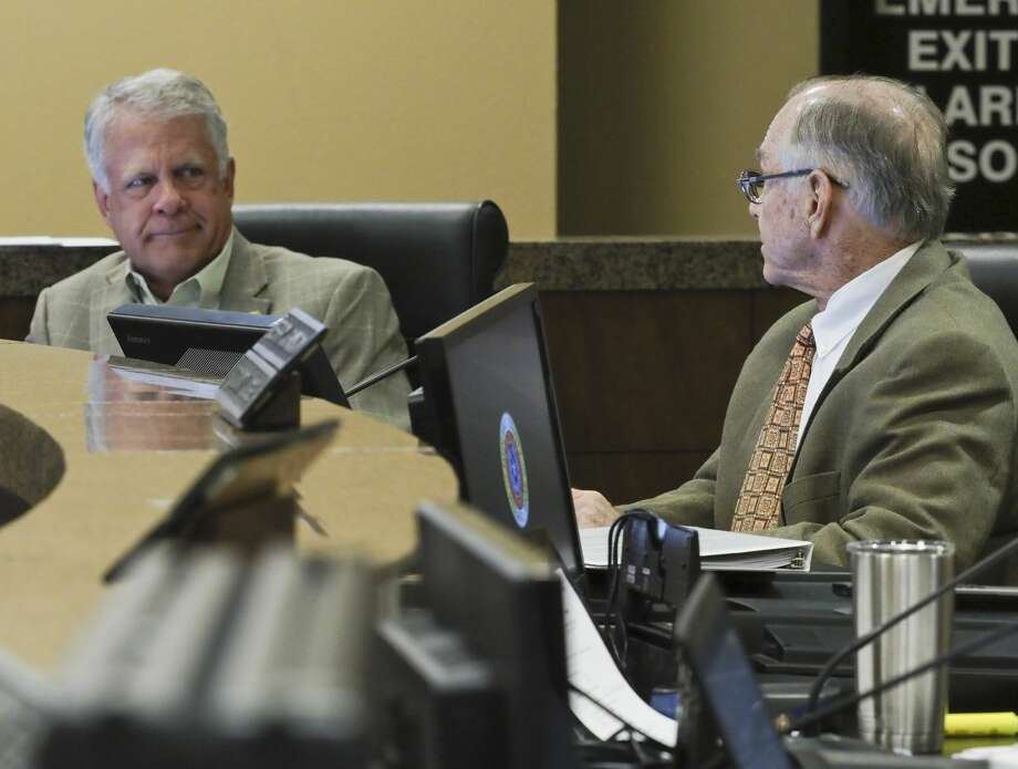 County Commissioners Scott Ramsey and Robin Donnelly look to each other to second after Commissioner Randy Prude brought back his nomination for Richard Gillette to be named interim Sheriff 06/10/19 at Commissioners Court. Tim Fischer/Reporter-Telegram Photo: Tim Fischer/Midland Reporter-Telegram