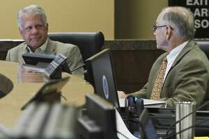 County Commissioners Scott Ramsey and Robin Donnelly look to each other to second after Commissioner Randy Prude brought back his nomination for Richard Gillette to be named interim Sheriff 06/10/19 at Commissioners Court. Tim Fischer/Reporter-Telegram