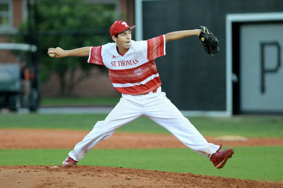 Josh Wolf of St. Thomas delivers a pitch in the third inning of a varsity baseball game between the St. Pius X Panthers and the St. Thomas Eagles on Saturday April 8, 2017, at St. Pius X High School in Houston. Photo: Craig Moseley, Staff / Houston Chronicle / ©2017 Houston Chronicle