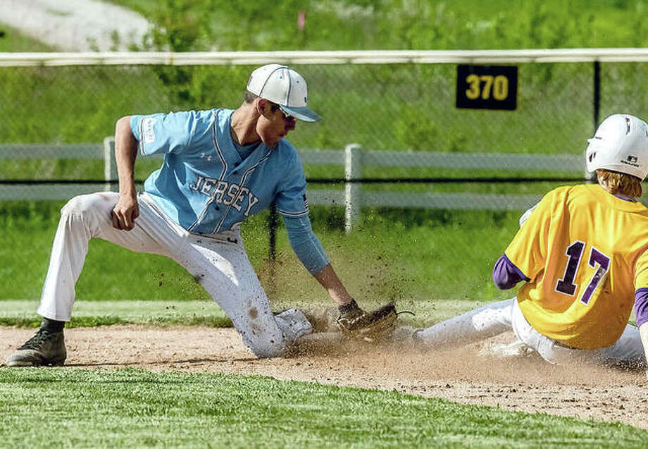 Jerseyville's Ethan Snider, left, is one of a host of returning players on the Post 492 Senior American Legion Baseball team this summer. Snider is shown tagging out a CM baserunner at second in a high school game this spring. Photo: Telegraph Photo