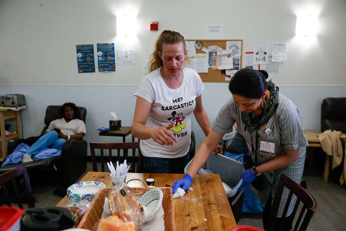 Nurse Michelle Absher (left) and nursing student Farheen Malik (right) clean up after a client made a mess during breakfast at the Dore Urgent Care clinic which is a crisis drop-in center for mental health needs in San Francisco, California, on Monday, June 10, 2019. Supervisors Matt Haney and Hillary Ronen have proposed a sweeping ballot measure to overhaul the city's mental health care system.