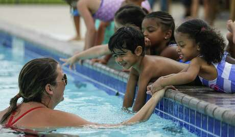Children should learn to swim in a safe environment and many organizations such as the YMCA or American Red Cross offer lessons for free or a small fee.