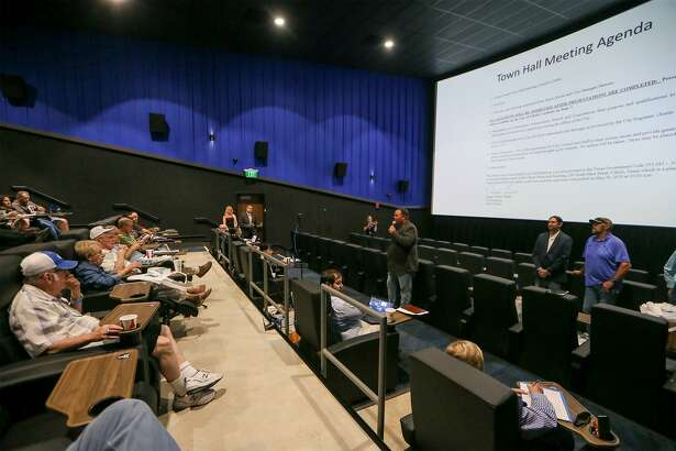 Cibolo Mayor Stosh Boyle, standing center, addresses attendees of a city of Cibolo Town Hall meeting at the new Santikos Family Entertainment Center on June 5.