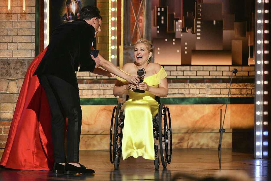 "Laura Benanti, from left, and Anthony Ramos present Ali Stroker the award for best performance by an actress in a featured role in a musical for her work in ""Rodgers & Hammerstein's Oklahoma!"" at the 73rd annual Tony Awards on Sunday. Photo: Charles Sykes, INVL / Associated Press / Invision"