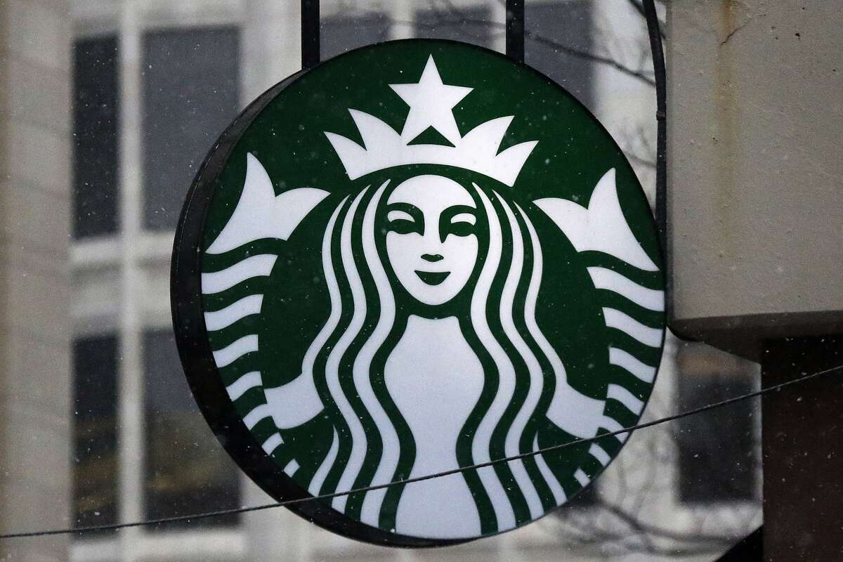 FILE - This March 14, 2017 file photo shows the Starbucks logo on a shop in downtown Pittsburgh.