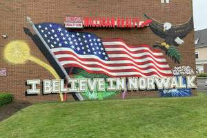 The mural on the side of the building at 11 Belden Ave., done by the local artist Action, June 10, 2019 in Norwalk, Conn.