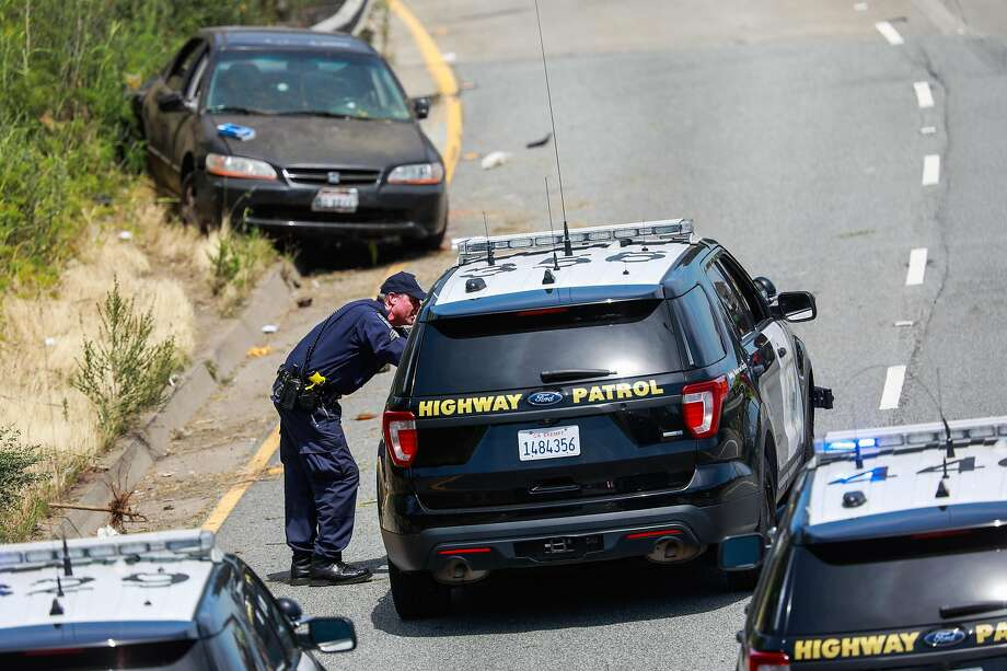 Police cars block the exit to the freeway at the scene of a shooting off of highway I-280 near San Jose Avenue in San Francisco, California, on Monday, June 10, 2019. Two people were shot and sent to the hospital. Photo: Gabrielle Lurie, The Chronicle
