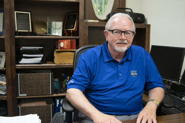 Dr. Paul Sadler sits in his office in the Brown Family Conference Center at Wayland Baptist University. Sadler was granted emeritus status, retiring after 29 years of service at Wayland.