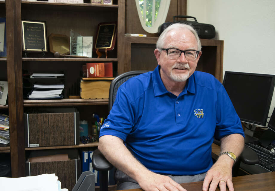 Dr. Paul Sadler sits in his office in the Brown Family Conference Center at Wayland Baptist University. Sadler was granted emeritus status, retiring after 29 years of service at Wayland. Photo: Jonathan Petty, WBU/Courtesy Photo