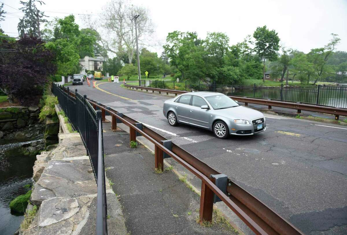 Cars pass over the Davis Avenue bridge at Bruce Park this past June. If the RTM signs off on the agreement next month, the town will be in line for state funding to help pay for bridge repairs throughout town.
