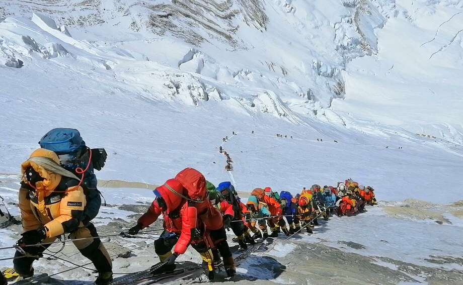 A reader speculates about the root cause of overcrowding on Mount Everest, where at least 11 climbers have died this season. Here, climbers line up below Camp 4 last month. Photo: Rizza Alee /Associated Press / Copyright 2019 The Associated Press. All rights reserved.