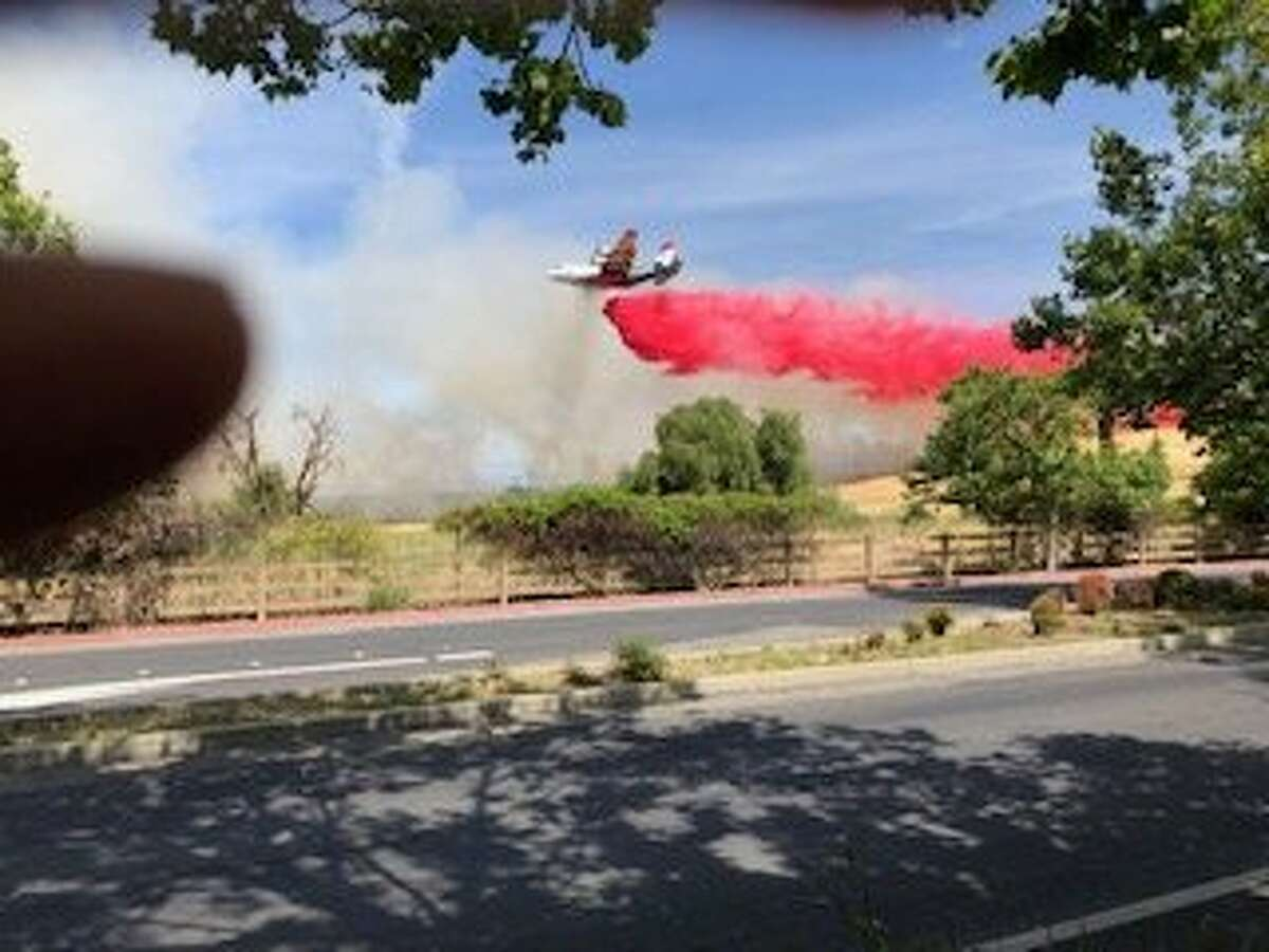 """A Calfire air tanker drops fire retardant on a fire that burned Monday, June 10, 2019 near Concord. Dubbed the """"Willow Fire, the flames consumes 25 acres on federal land but no structures or homes were threatened."""