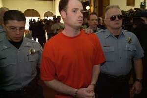 Randy Halprin is led into the Teller County Courthouse in Cripple Creek, Colo. as the two of the 'Texas Seven' escapees appeared in 4th Judicial District Court for a hearing on their extradition to Texas Friday afternoon, Jan. 26, 2001. Both plan to fight the extradition, and a hearing was set for Feb. 22 for both of their cases. (Smiley N. Pool/Chronicle) 01/26/01