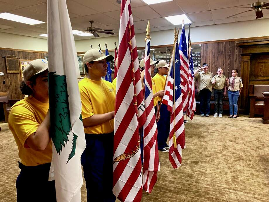 About 50 U.S. flags were retired during a special ceremony on Saturday. Photo: Don Brown/For The Herald