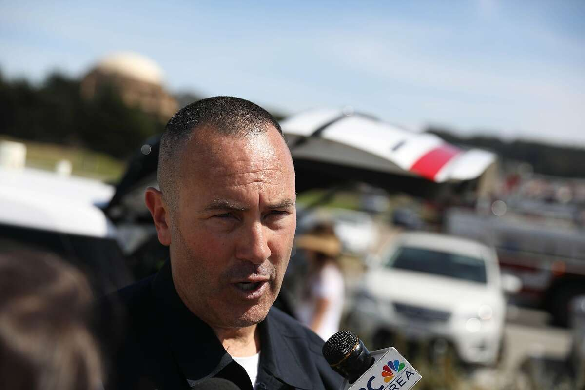 Lieutenant Jonathan Baxter speaks during a news conference at Crissy Field regarding a 14-year-old boy who seen struggling in the water and pulled from the water after being spotted about 25 yards from the shoreline by divers on Monday, June 10, 2019 in San Francisco, Calif.