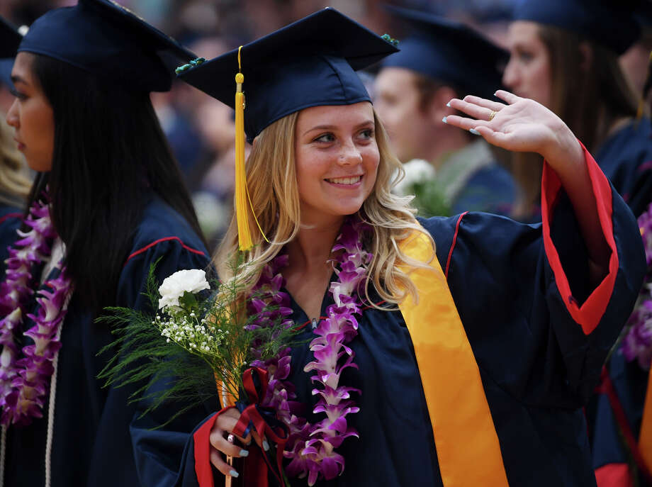 Graduate Kelly Strom waves to family in the stands during the Foran High School Graduation in Milford, Conn. on Monday, June 10, 2019. Photo: Brian A. Pounds, Hearst Connecticut Media / Connecticut Post
