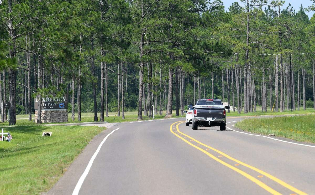 Commuters drive on Farm Road 421 in Lumberton Monday. A private developer has purchased a large section of land north of the road near the Lumberton City Park for development. Photo taken Monday, 6/10/19