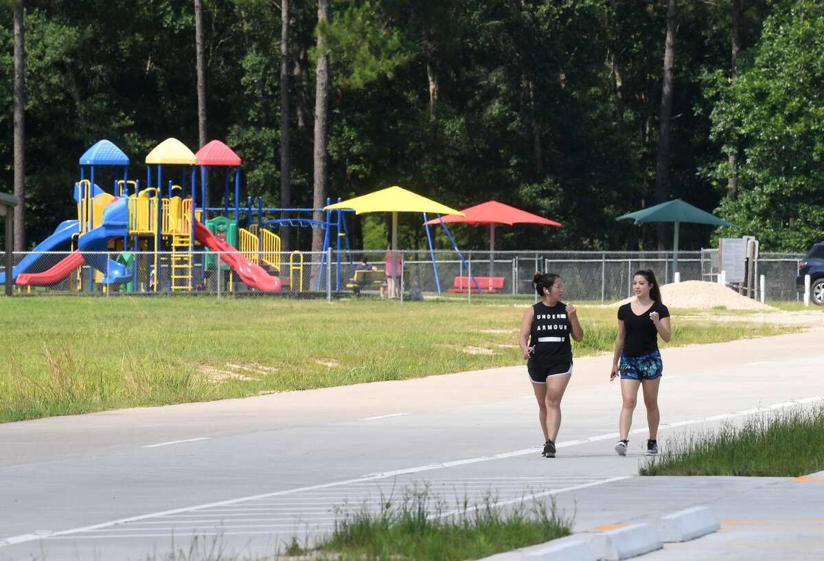 Victoria Ball, left, and Bailey Ball walk around the Lumberton City Park on Farm Road 421 Monday Afternoon. A private developer has purchased a large section of land north of the park for development. Photo taken Monday, 6/10/19